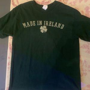 Dark green shirt sleeve T-shirt.
